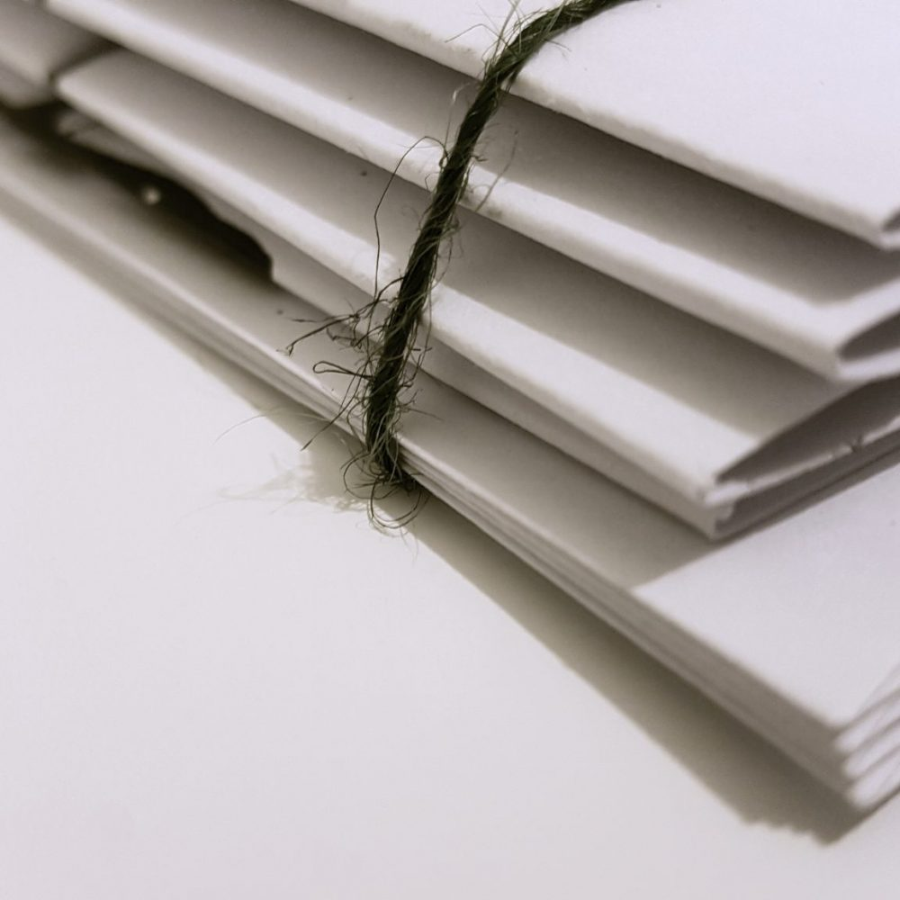 image of stacked documents representing articles